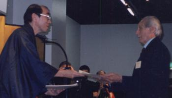 Dan Ivan Receives 8th dan from Tokugawa descendent