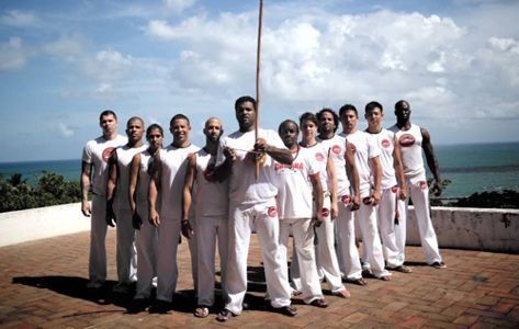 Worldwide Instructors of Capoeira Camara (Mestre Bola in Front – Ivan Outerbridge on left shoulder)